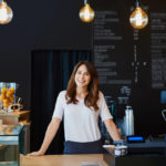 woman in restaurant with energy management system
